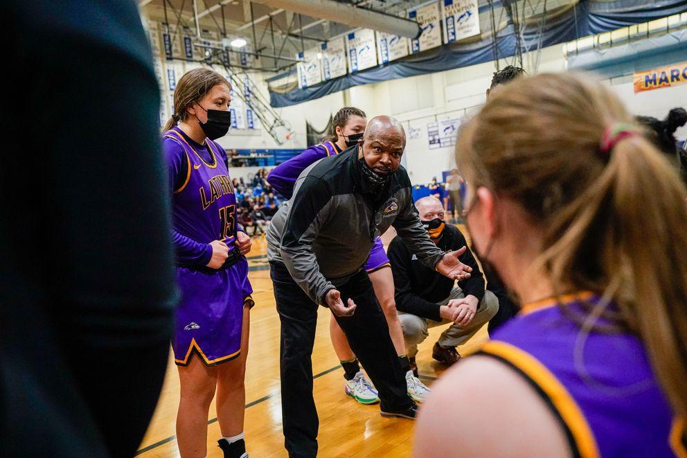 Lathrop coach Dave Stewart talks with his team. (Loren Holmes / ADN)
