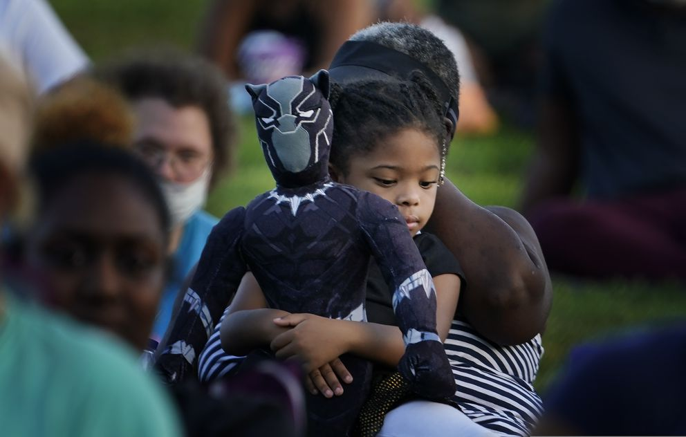 Khloe Murray, 5, of South Carolina, holds her Black Panther doll during a Chadwick Boseman Tribute on Thursday, Sept. 3, 2020, in Anderson, S.C. (AP Photo/Brynn Anderson)