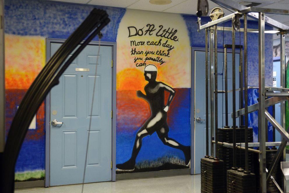 Inmate murals brighten the downstairs common area. (Erik Hill / Alaska Dispatch News)