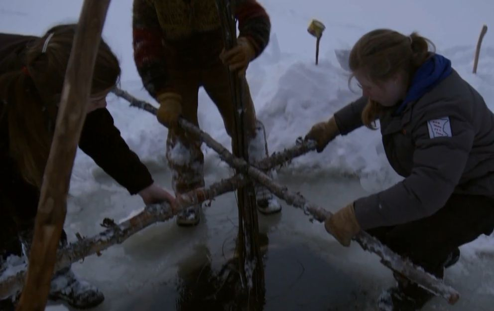 "The Lewis girls set a beaver trap in ""The Last Alaskans"" (Screen capture via Discovery.com)"