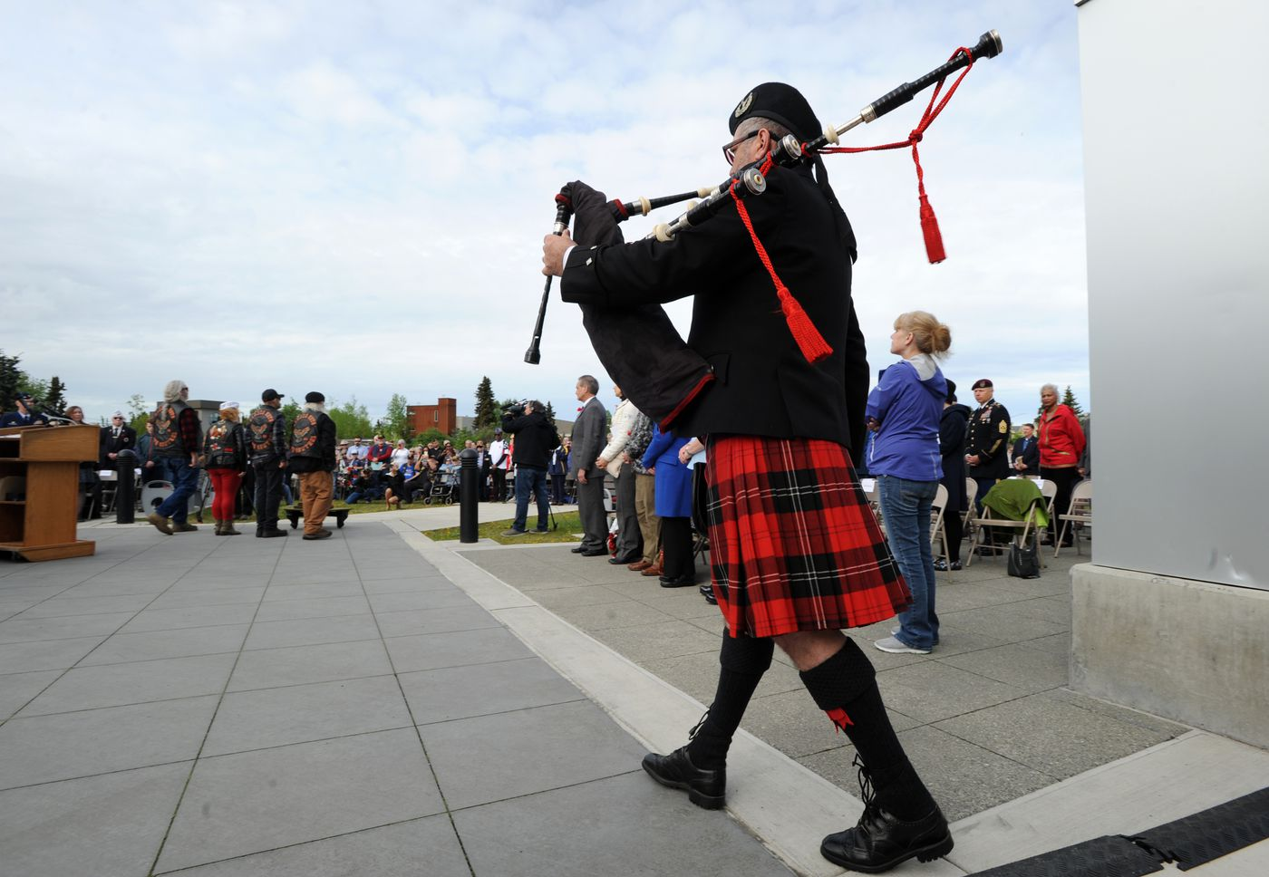 Ian White of the Crow Creek Pipes steps forward to play Amazing Grace for the Fallen Warrior ceremony during the Memorial Day remembrance. (Anne Raup / ADN)