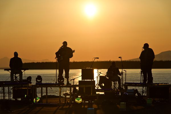 Medium build plays as the sun sets Tuesday. Musicians performed at the Ship Creek small boat launch in Anchorage on April 27, 2020. The recorded performances will become the AK4AK virtual music festival, to be shown online starting May 1. (Marc Lester / ADN)