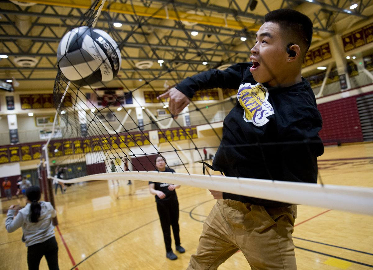 Alakanuk's Jeremiah Hootch practices with his mixed six volleyball team Wednesday in preparation for Thursday's first round of the state tournament Thursday at Dimond High. (Marc Lester / ADN)