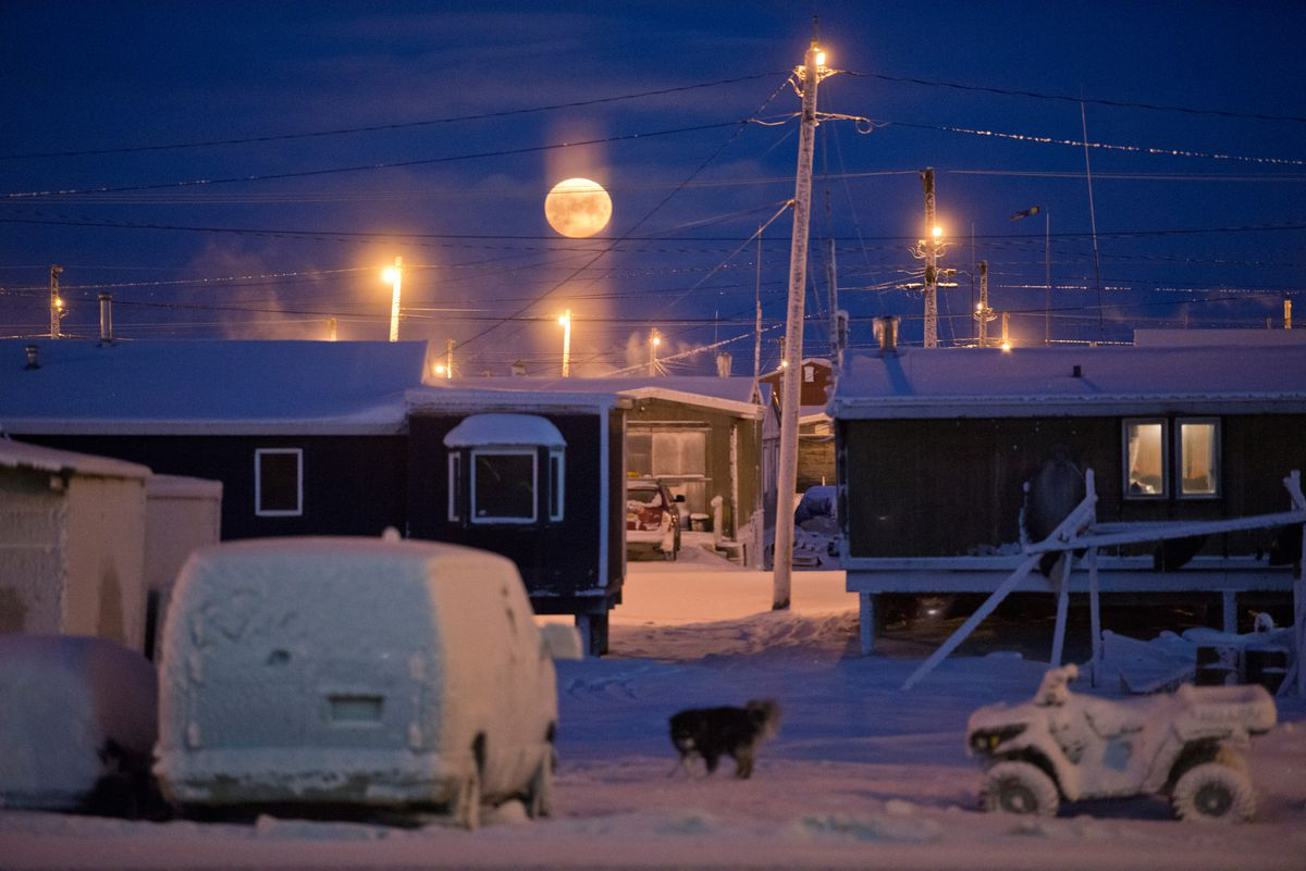 The full moon rises into view from Utqiagvik on Dec. 13, 2016. (Marc Lester / ADN)