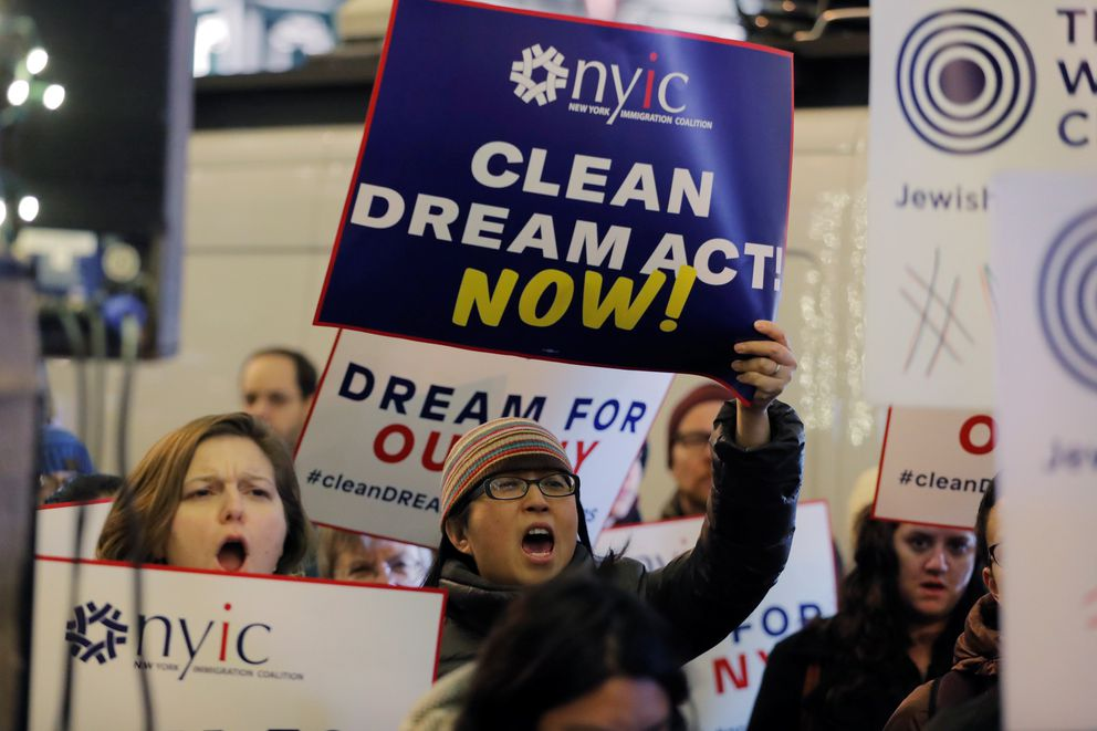 FILE PHOTO: Activists demonstrate outside the New York office of Sen. Chuck Schumer (D-NY) to ask for the passage of a 'clean' Dream Act, one without additional enforcement or security, in New York, U.S., January 10, 2018. REUTERS/Lucas Jackson
