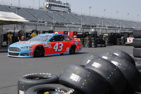FILE - In this Sept. 4, 2015, file photo, Aric Almirola heads for the track during a NASCAR Sprint Cup auto racing practice session at Darlington Raceway in Darlington, S.C. NASCAR will resume its season without fans starting May 17 at Darlington Raceway in South Carolina. As NASCAR speeds back to the race track during the coronavirus pandemic the series has a heavy responsibility to set a safety standard that doesn't slow the return of other sports. (AP Photo/Terry Renna, File)