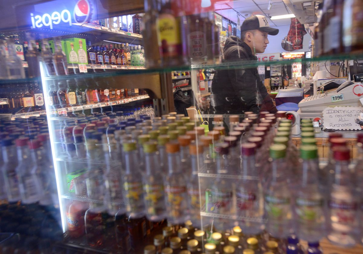 Eddy Lee talks about his family's business at Mom and Pop's Liquor Store. (Anne Raup / ADN)