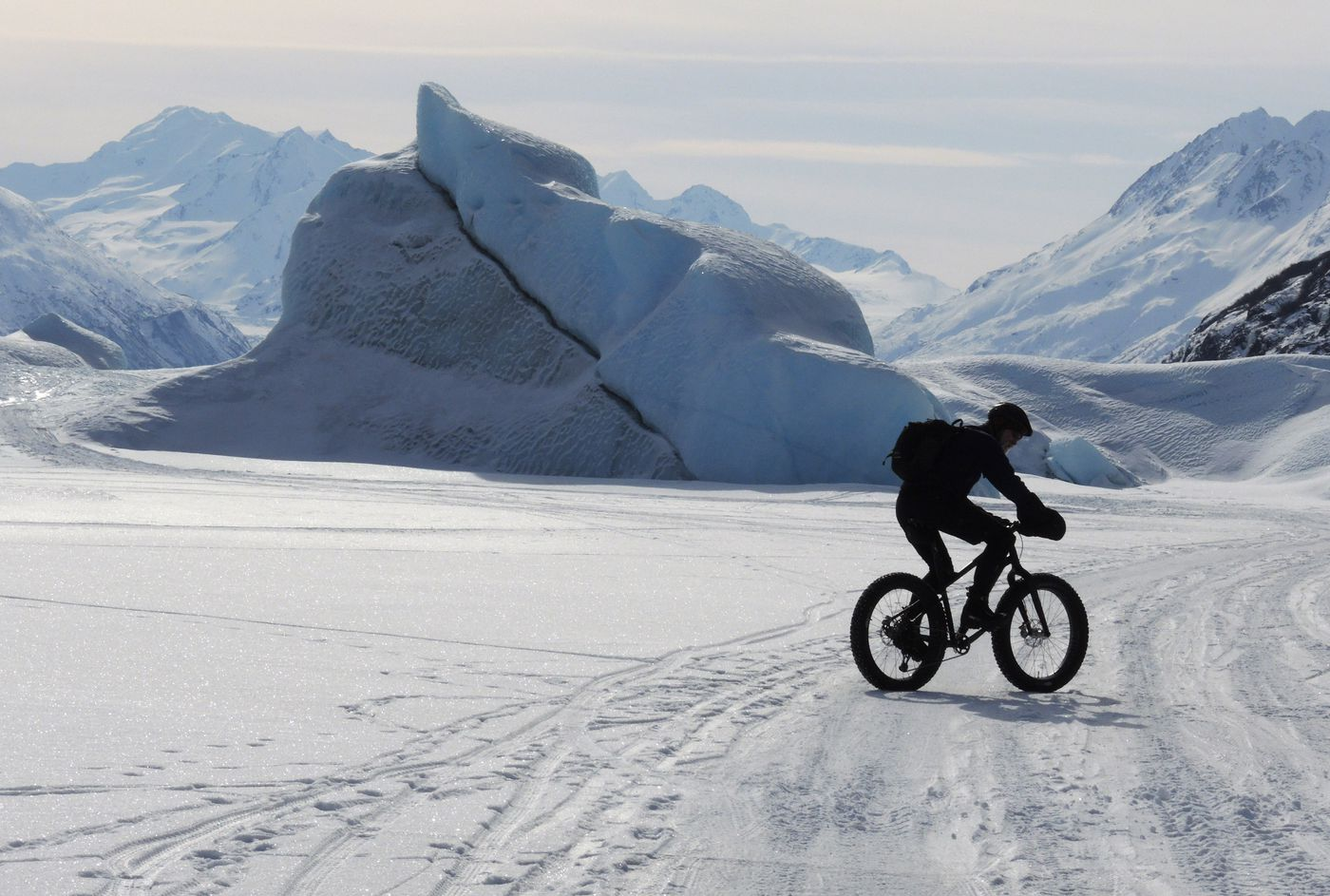 A biker rides on the frozen surface of the lake at the toe of Knik Glacier on Wednesday, March 24, 2021. (Anne Raup / ADN)