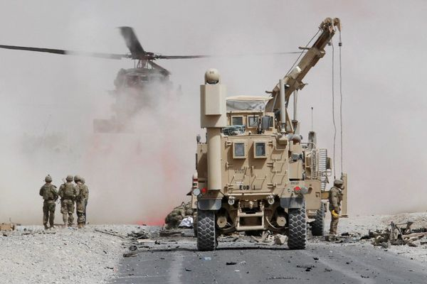 U.S. troops assess the damage to an armoured vehicle of NATO-led military coalition after a suicide attack in Kandahar province, Afghanistan August 2, 2017.REUTERS/Ahmad Nadeem