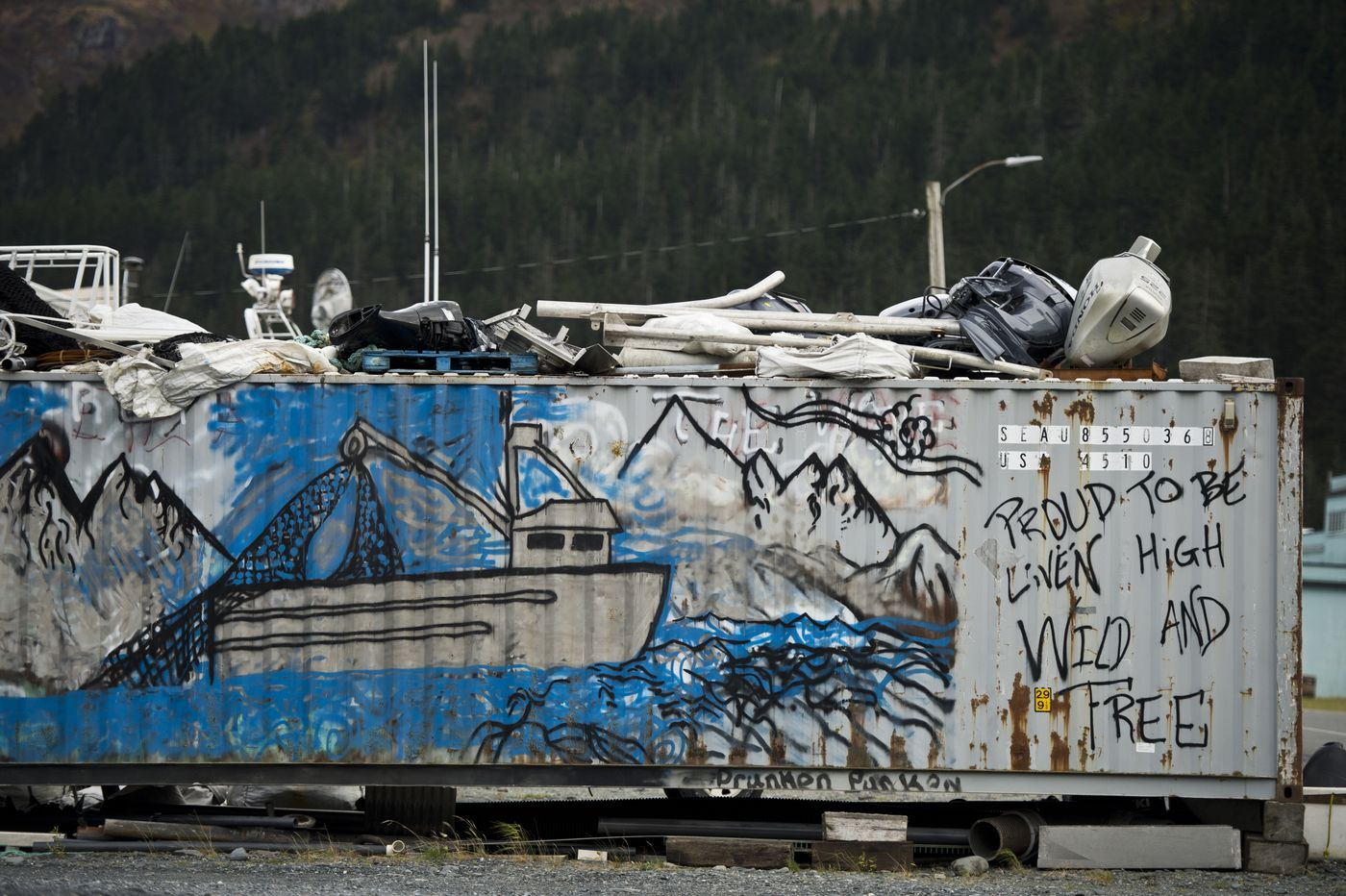 A fishing boat is painted on a storage container in Whittier on Oct. 10. (Marc Lester / Alaska Dispatch News)