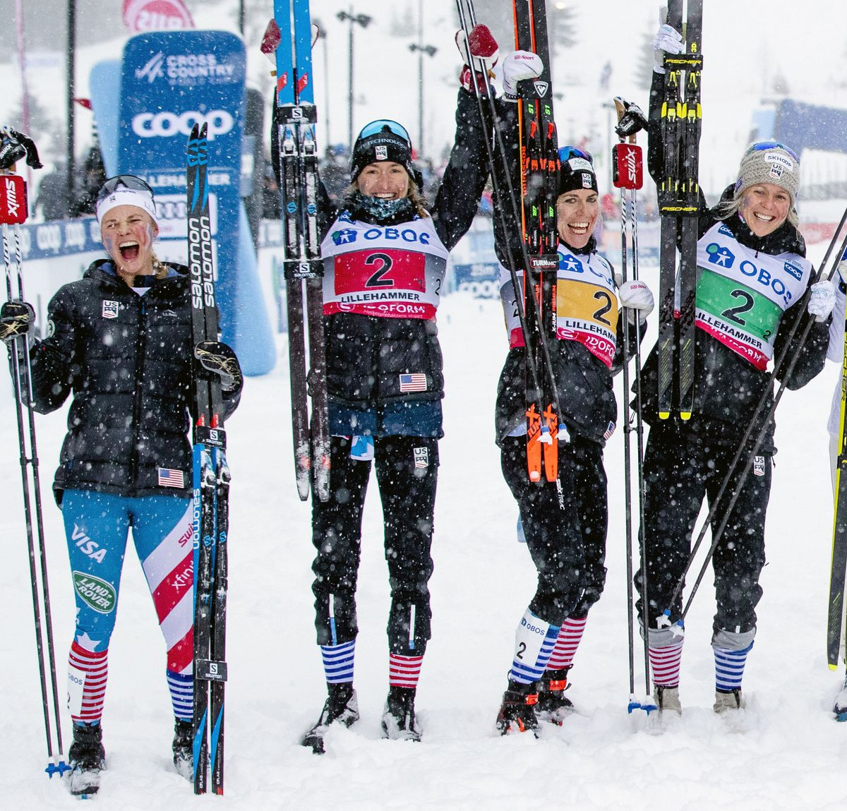From left, Jessie Diggins, Sophie Caldwell, Rosie Brennan and Sadie Maubet Bjornsen celebrate their second-place finish in a World Cup relay race Sunday in Lillehammer, Norway. (Stian Lysberg Solum/NTB scanpix via AP)