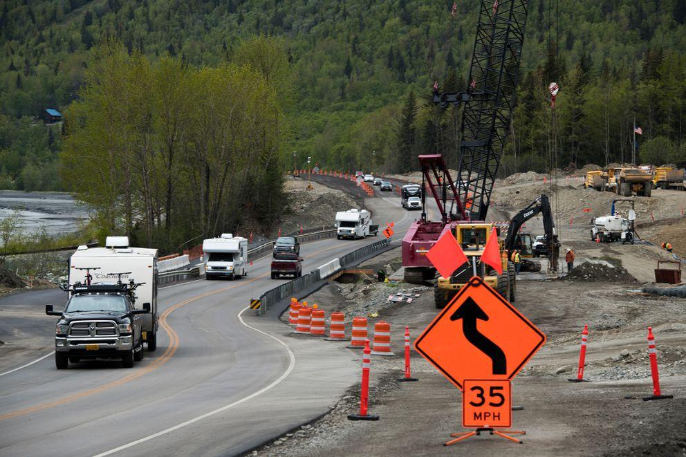 Vehicles pass a construction zone near Bird Creek on the Seward Highway on Thursday. (Marc Lester / ADN)