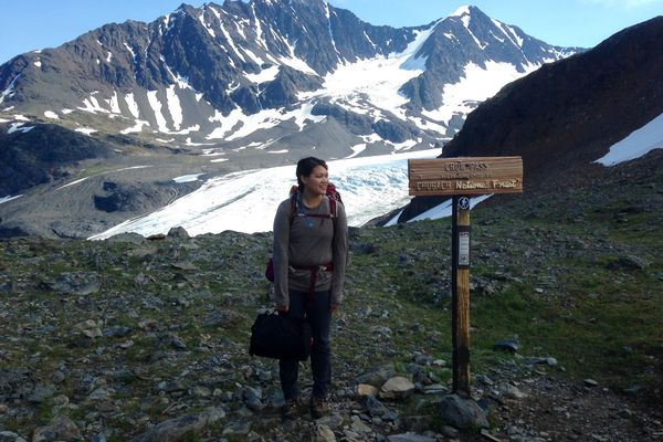 Like a total rookie, I carried a bear canister in one hand for the duration of my first solo backpacking trip along part of the Crow Pass Trail in July 2015. (Vicky Ho)