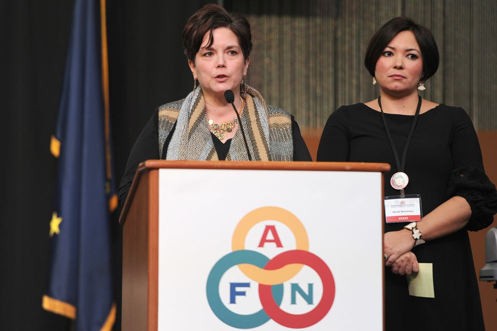 Christy Lawton and Nicole Borromeo talk about the Alaska Tribal Child Welfare Compact prior to its signing on the opening day of the Alaska Federation of Natives convention at the Dena'ina Center in Anchorage on Thursday, Oct. 19, 2017. (Bill Roth / Alaska Dispatch News)