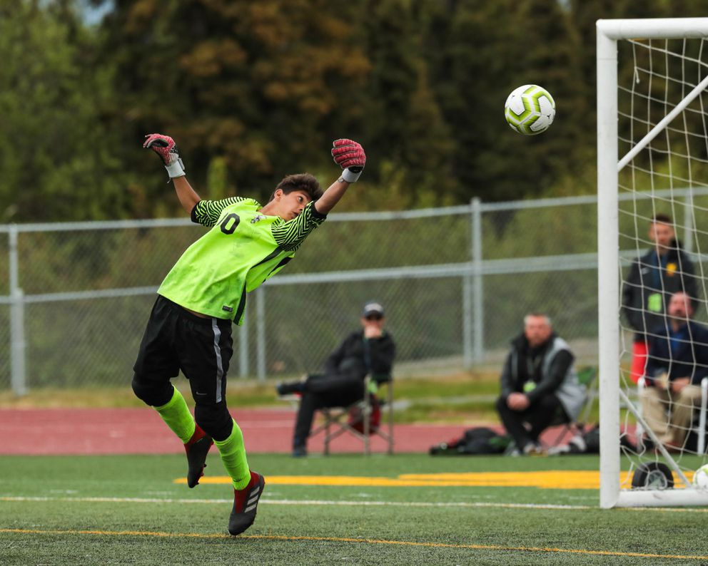 West goaltender Reese Schrage taps the ball to make a save during the state high school soccer match against Colony Saturday, May 25, 2019 at Service High. (Loren Holmes / ADN)