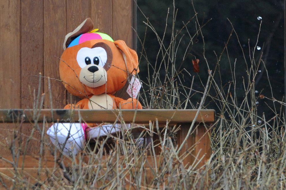 A teddy bear sits on a deck is West Anchorage on Thursday. (Bill Roth / ADN)