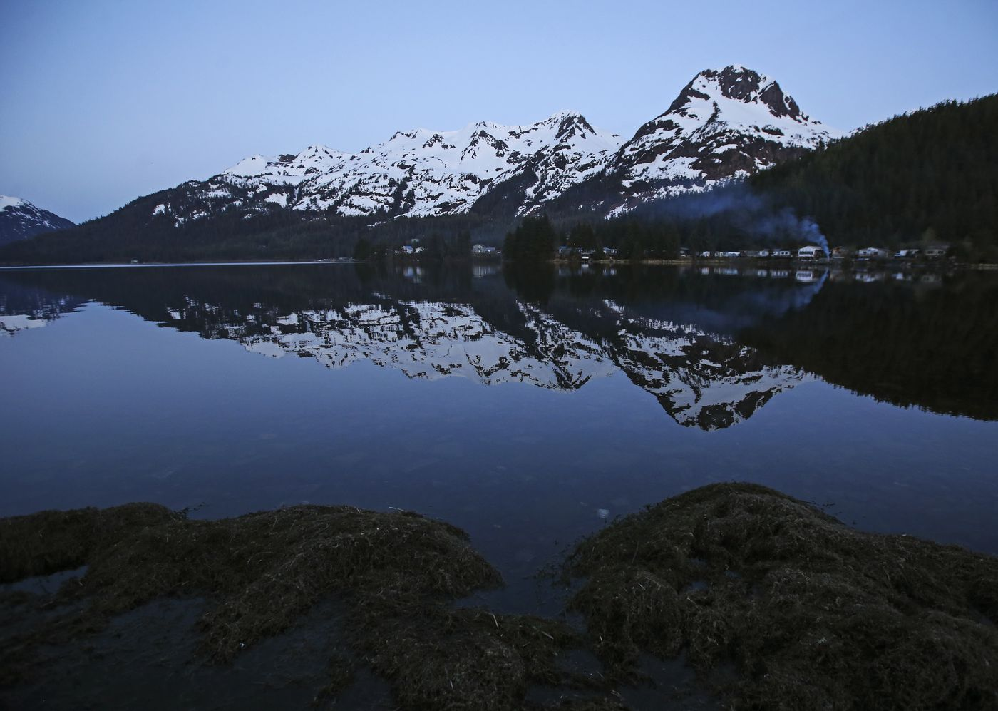 Mt. Eccles reflects in Eyak Lake just after sunset in Cordova on Monday, May 17, 2021. (Emily Mesner / ADN)