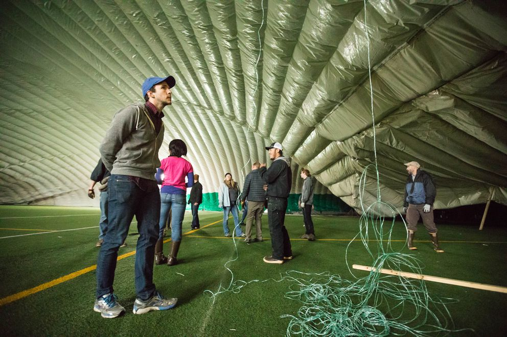 Volunteers wait for air pressure to rebuild inside The Dome on Saturday, Sept. 16, 2017. (Loren Holmes / Alaska Dispatch News)
