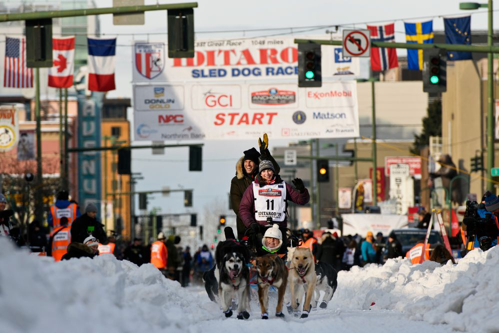 Rookie musher Blair Braverman leaves the starting line on 4th Avenue. Fifty-two mushers and dog teams ran across Anchorage for the ceremonial start of Iditarod 2019 on March 2, 2019. (Marc Lester / ADN)