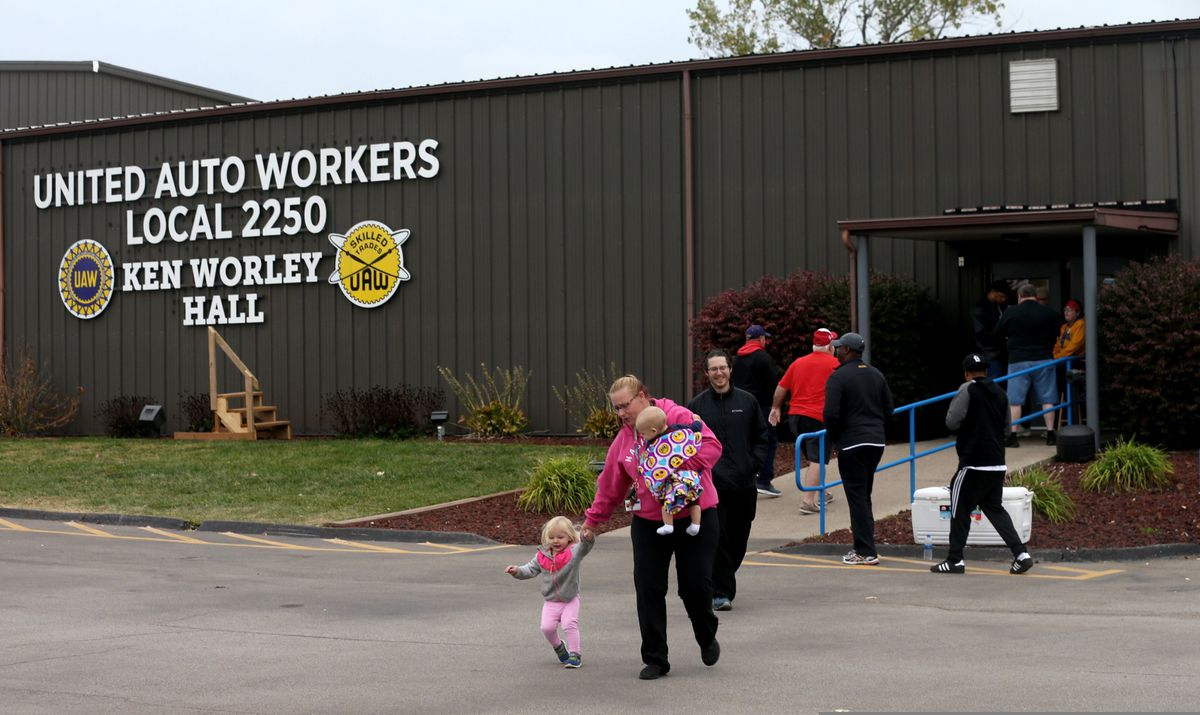 FILE - In this Thursday, Oct. 24, 2019 file photo, United Auto Worker Lindsey Higgins, exits the the UAW Local 2250 Ken Worley Hall with her two children after voting on the offer made to union workers by General Motors in Wentzville, Mo. General Motors workers voted 57.2% in favor of a new contract with the company, bringing an immediate end to a contentious a 40-day strike that paralyzed GM's U.S. factories, Friday, Oct. 25, 2019. (Laurie Skrivan/St. Louis Post-Dispatch via AP, File)