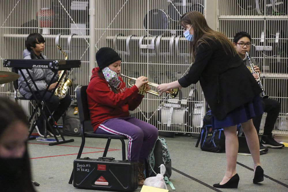 Dayna Spaulding gives instructions to Maiyer Moua during band class at Begich Middle School on Tuesday, March 16, 2021.