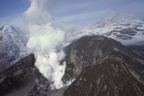 A steam plume rises from the 7,575-foot Crater Peak on September, 23, 1992, after a large ash eruption. Mount Spurr which rises 11,070 feet above sea-level, is slighty obscured by clouds at top of photo. (Bill Roth / ADN archive)