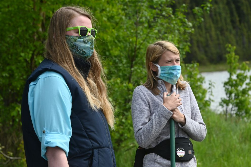 Trailside Discovery Camp Director Vicki Long-Leather, left, and program manager Acadia Graham watch children paddle at Goose Lake in Anchorage on Monday, June 1, 2020. (Bill Roth / ADN)