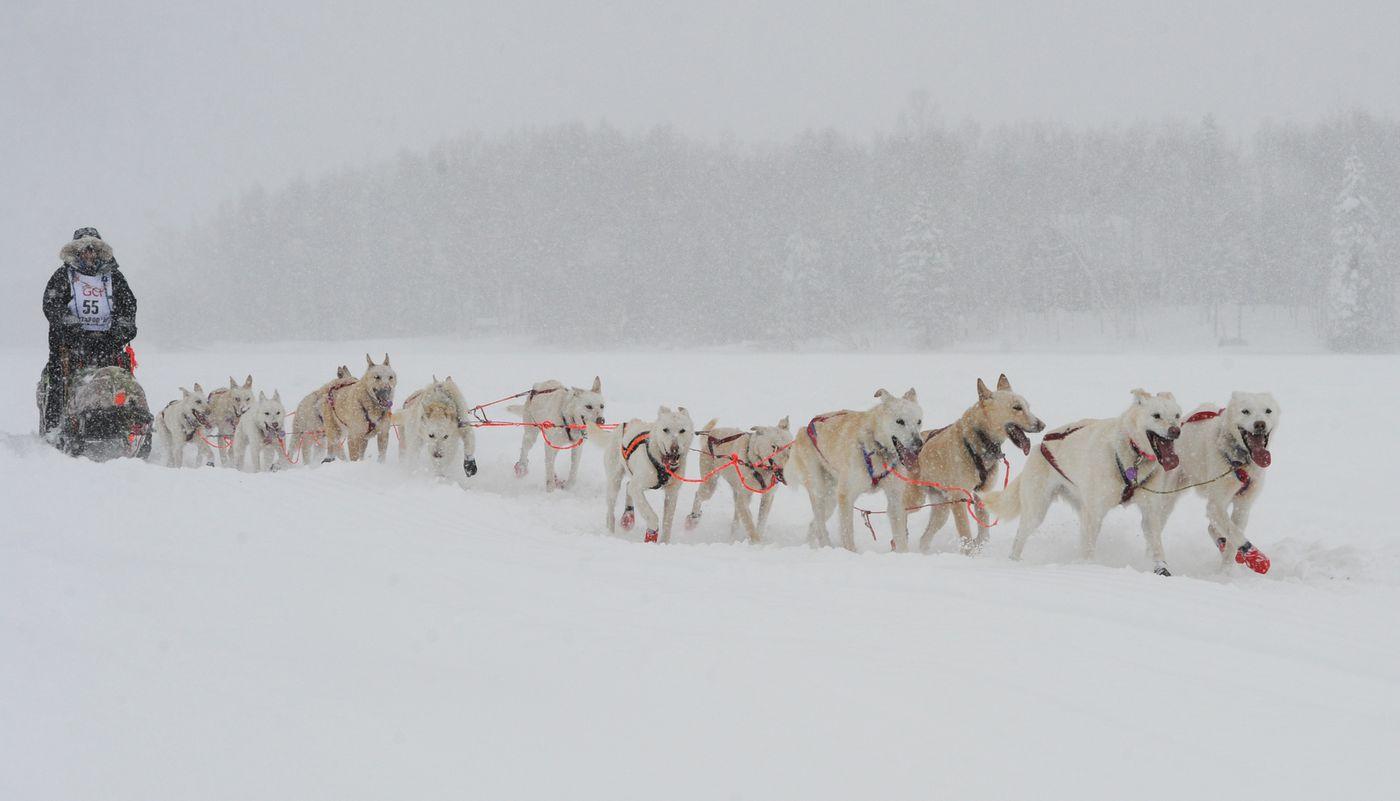 Jim Lanier of Chugiak drives his dog team across Long Lake on Sunday. (Bill Roth / ADN)