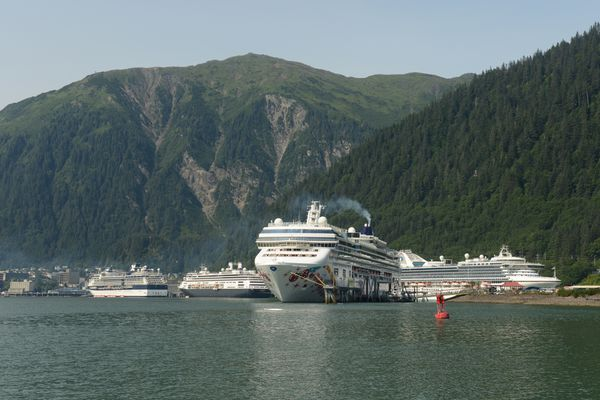 Four huge cruise ships are docked at the state capital of Juneau in southeast Alaska on Tuesday, July 24, 2018. (Bob Hallinen / ADN)