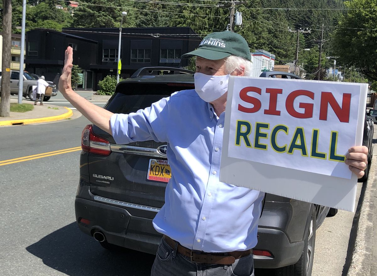 Ben Muse Sr. holds a sign on Thursday, July 2, 2020 urging Alaska voters to sign the recall petition seeking to remove Alaska Gov. Mike Dunleavy from office. (James Brooks / ADN)