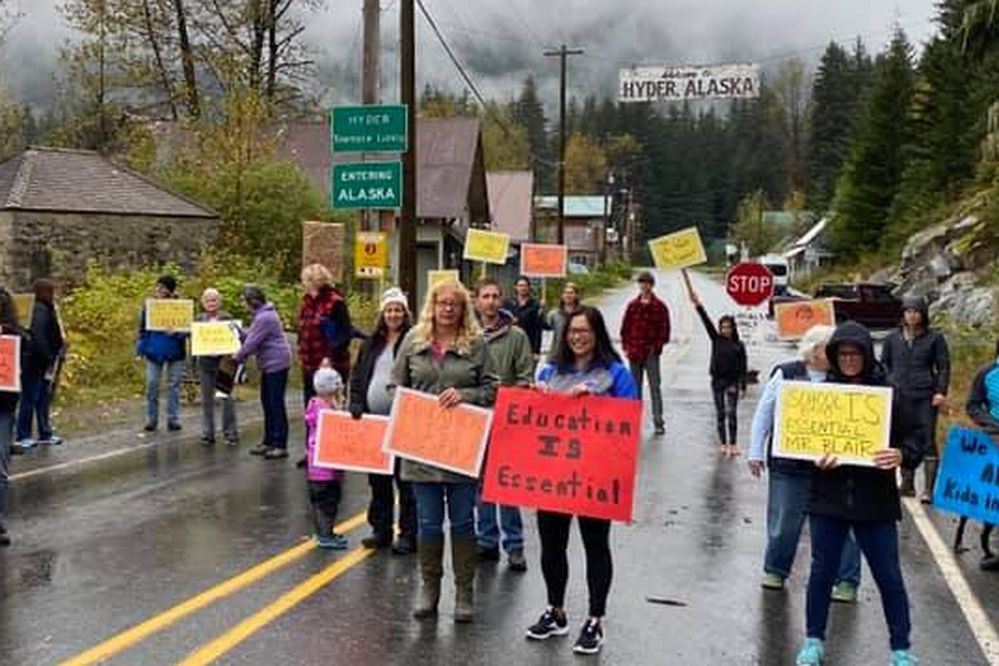 Residents of Hyder, Alaska, rally at the Alaska-Canada border on Sept. 19, 2020. Residents of Hyder and neighboring Stewart, British Columbia, are pushing for eased border-crossing restrictions amid the COVID-19 pandemic. Photo by Jennifer Bunn.
