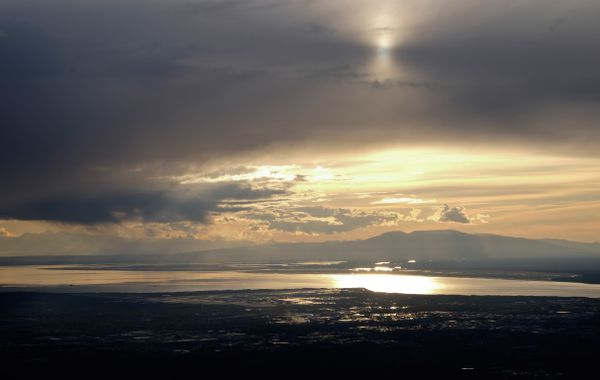 Dark clouds clear as the sun sets on June 2, 2013, seen in this view from Flattop Mountain. (Marc Lester / ADN archive)