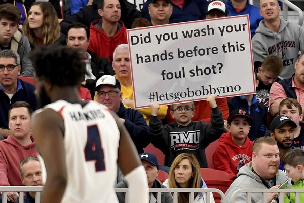 A Robert Morris fan holds up a sign during the team's NCAA college basketball game against St. Francis for the Northeast Conference men's tournament title Tuesday, March 10, 2020, in Pittsburgh. (Matt Freed/Pittsburgh Post-Gazette via AP)