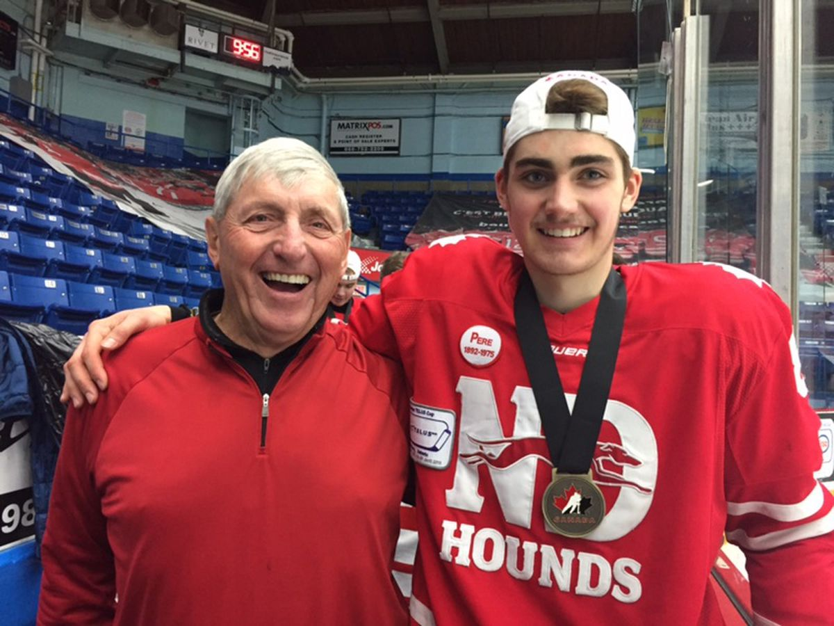 Eagle River's Zach Plucinski poses for a photo with his grandfather Gary McKissock after the Notre Dame Hounds' victory in the Telus Cup final on April 29. (Photo courtesy Heather Plucinski)