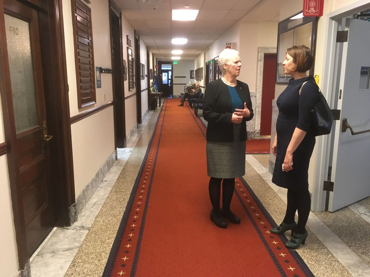 Rep. Louise Stutes, R-Kodiak (left) speaks to Frances Leach, executive director of the United Fishermen of Alaska, on Tuesday, April 16, 2019. Stutes is among the lawmakers opposing the appointment of Karl Johnstone to the Alaska Board of Fisheries. (James Brooks / ADN)