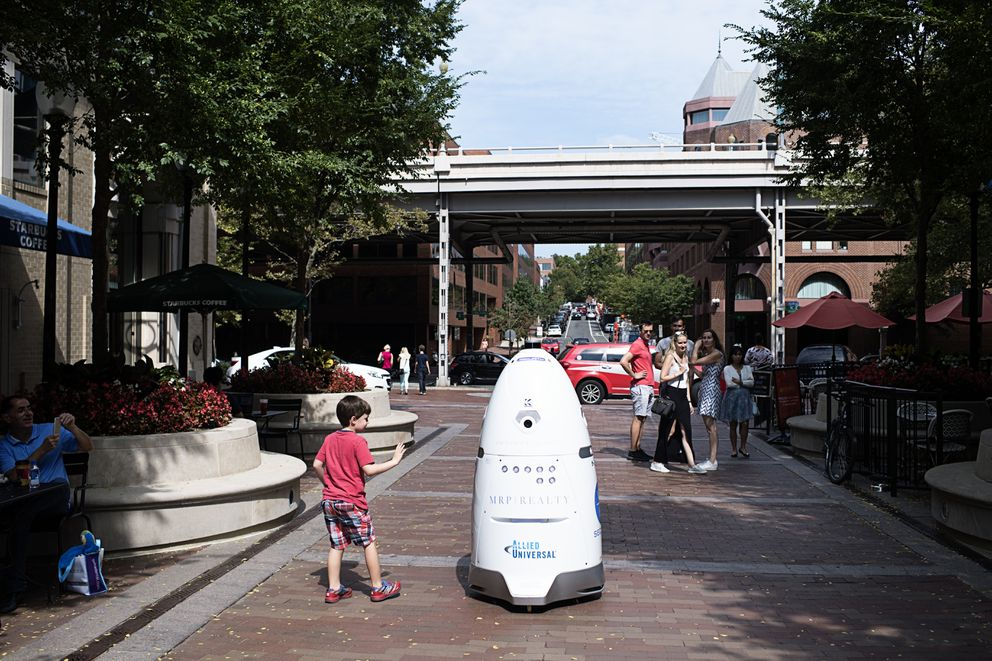 This security robot patrols the pedestrian breezeway of Washington Harbour in Washington, D.C., in September. It's predecessor drowned in a fountain over the summer. A model in the San Francisco Bay Area's pilot program was shut down following some incidents. (Washington Post photo by Marvin Joseph)