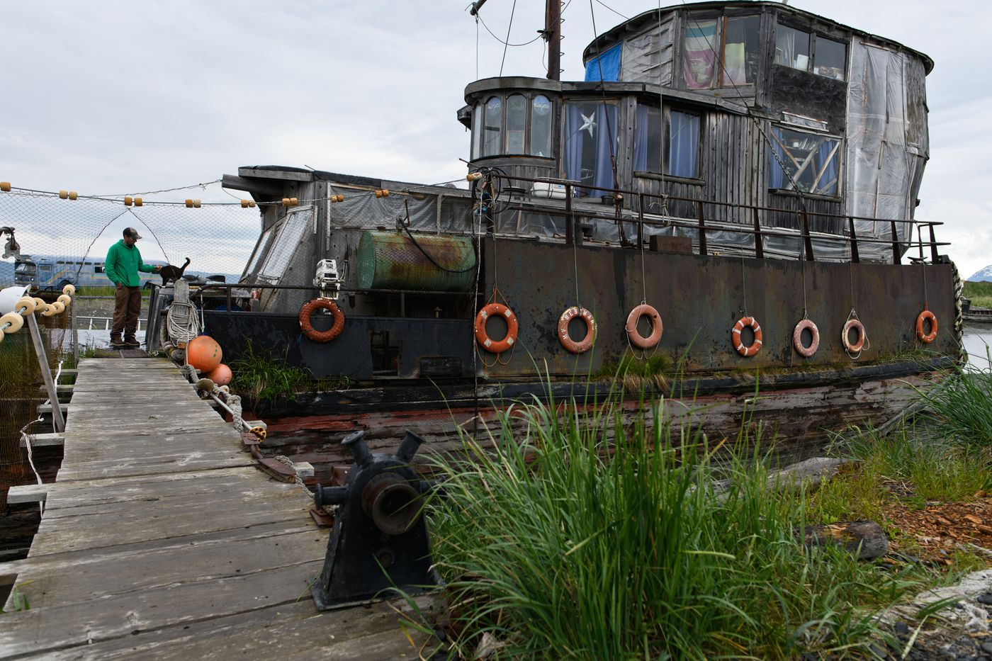 """Drew O'Neill lives with his family in an old boat on the Homer Spit. The boat, known to many as the """"pirate ship,"""" is a Homer landmark that regularly attracts attention from tourists. Photographed on June 19, 2018. (Marc Lester / ADN)"""