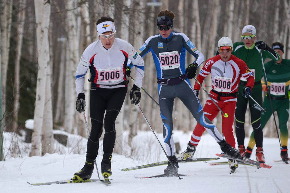 A pack of skiers led by Cody Priest (5006) and Adam Loomis (5020) ski the Chester Creek trail during the 50K race. (Anne Raup / ADN)