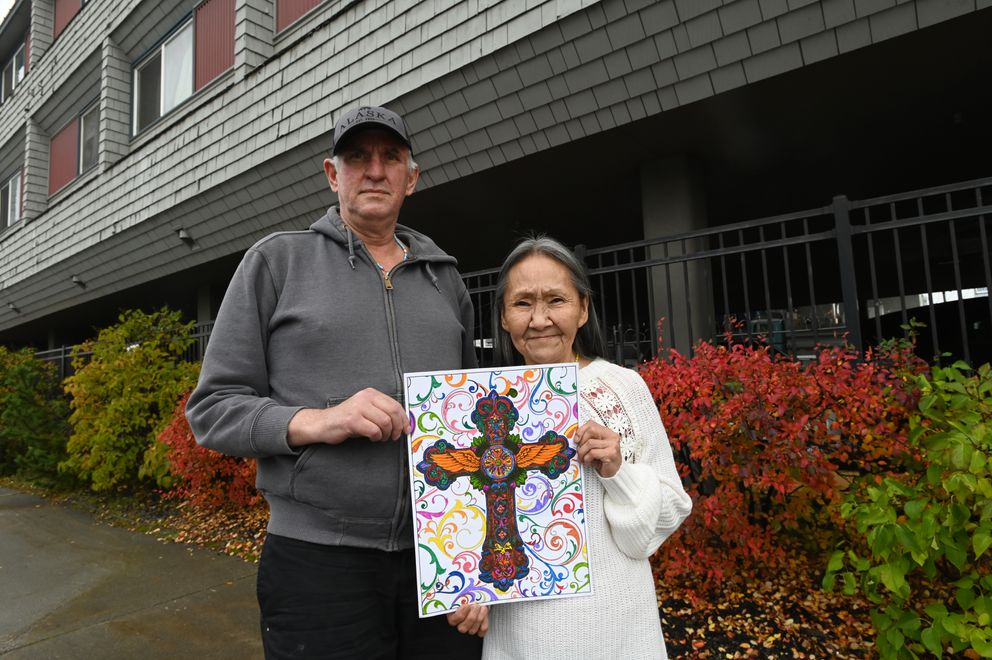 After years of living in homeless camps and shelters, Roger Williams and Lucy Tall were recently placed in permanent supportive housing at the Karluk Manor. The couple say they draw and color 'to help keep sober. ' (Bill Roth / ADN)