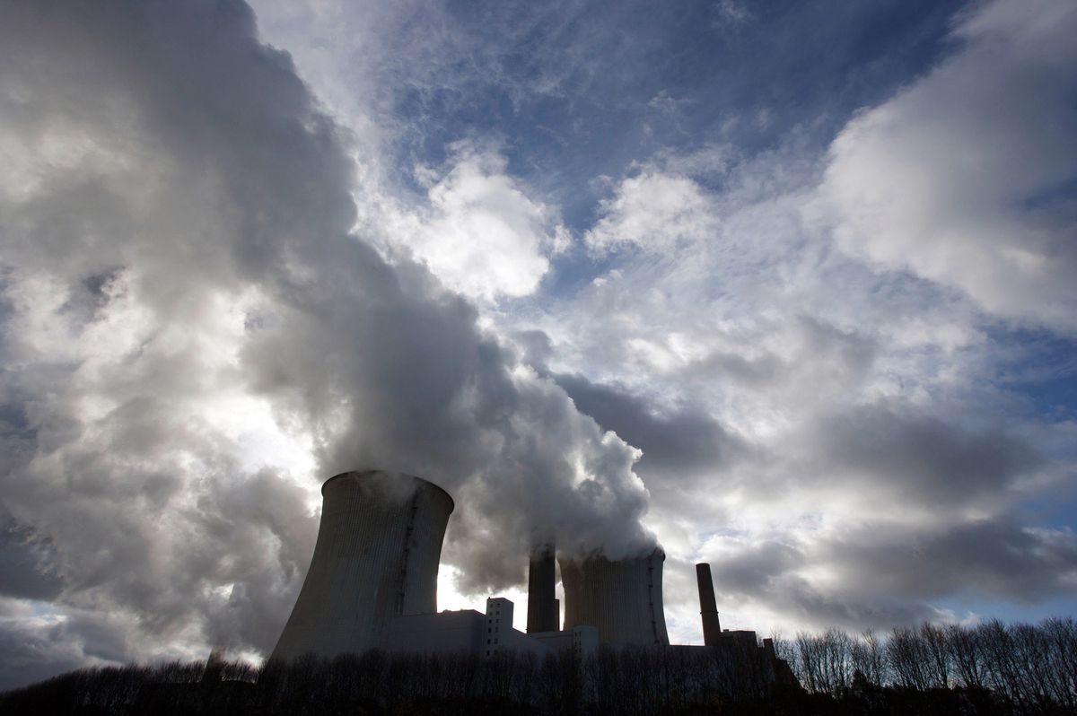 Smokestacks and cooling towers emit smoke and water vapor at the RWE AG owned coal-fired power station Neurath near Bergheim, Germany. (Bloomberg photo by Wolfgang von Brauchitsch)