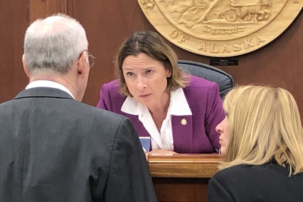 Senate President Cathy Giessel, R-Anchorage, speaks to Sen. Bert Stedman, R-Sitka and Sen. Natasha von Imhof, R-Anchorage, before the start of Monday's session of the Alaska Senate on July 29, 2019. (James Brooks / ADN)