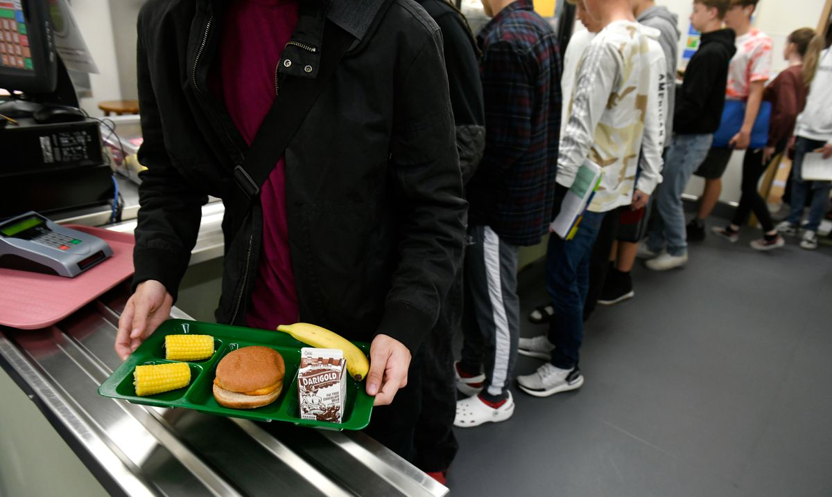 A Service High School student carries a lunch tray on Oct. 2, 2019. Service is one of the Anchorage School District schools that are using reusable trays instead of prepackaged disposable ones. (Marc Lester / ADN)