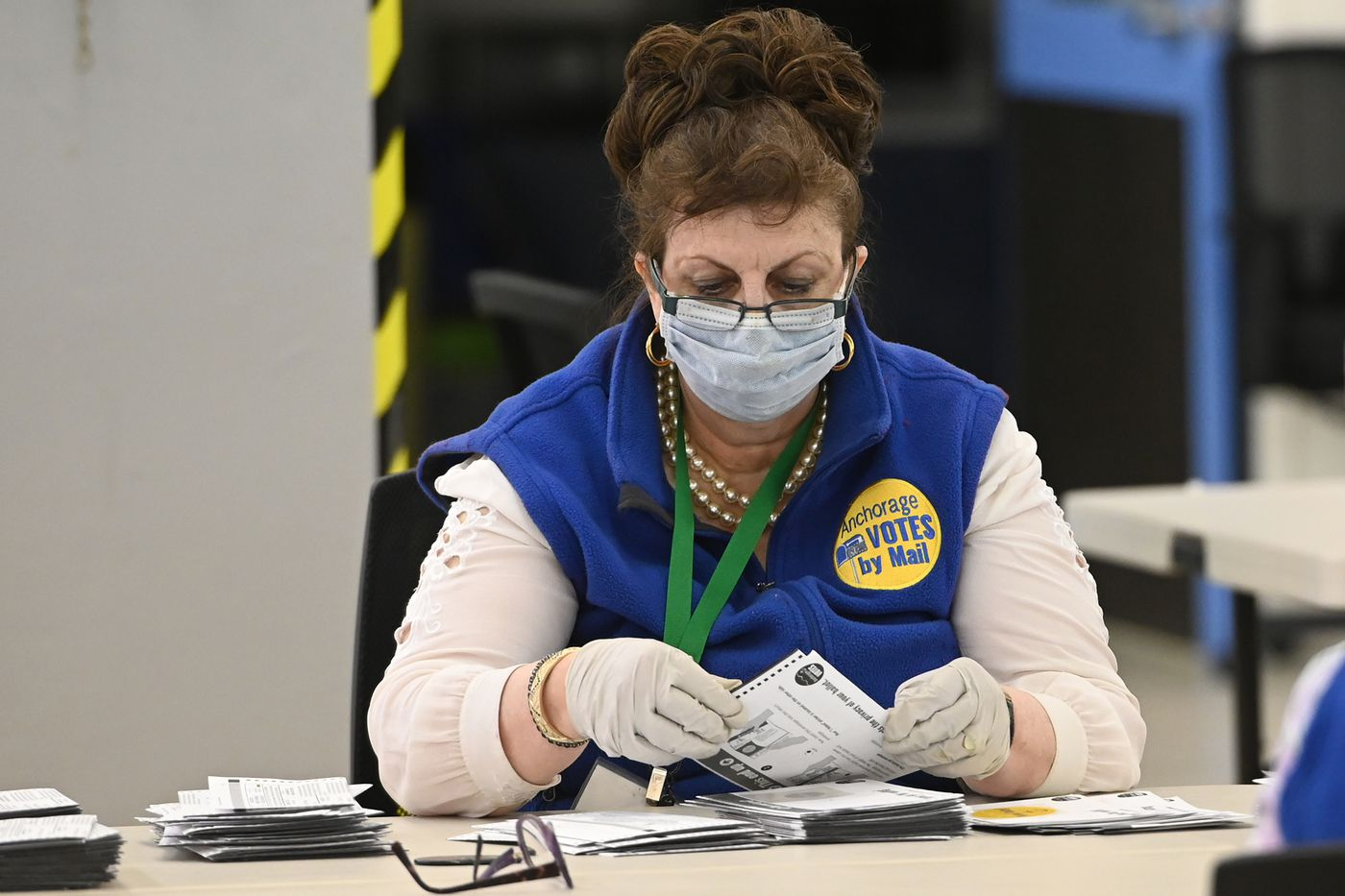 Election worker Jean Sondrud wore a mask while processing ballots at the MOA Election Center during the regular municipal election on Tuesday, April 7, 2020. (Bill Roth / ADN)
