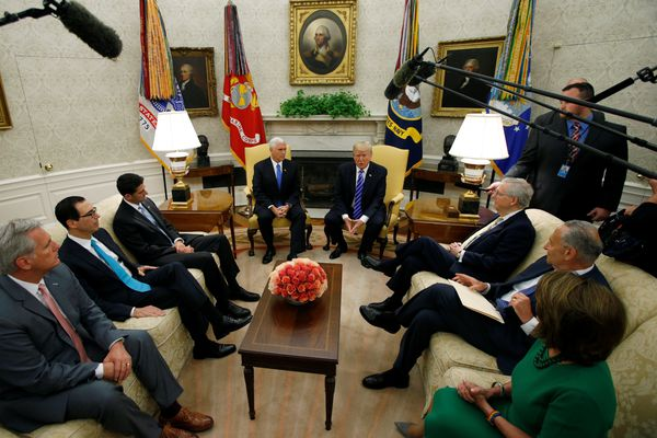 U.S. President Donald Trump meets with congressional leaders: House Majority Leader Rep. Kevin McCarthy, Treasury Secretary Steve Mnuchin, Speaker of the House Paul Ryan, Vice President Mike Pence, Senate Majority Leader Mitch McConnell, Senate Minority Leader Chuck Schumer and House Minority Leader Nancy Pelosi in the Oval Office of the White House in Washington, U.S., September 6, 2017. REUTERS/Kevin Lamarque
