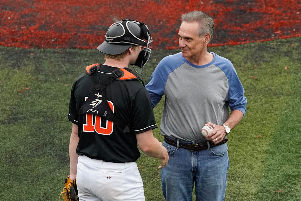 After throwing the ceremonial first pitch, Lt. Gov. Kevin Meyer talks with West catcher Luke Langnes. (Loren Holmes / ADN)