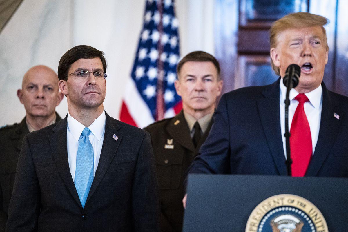 Defense Secretary Mark T. Esper listens Wednesday as President Trump addresses the nation from the White House. (Washington Post photo by Jabin Botsford)