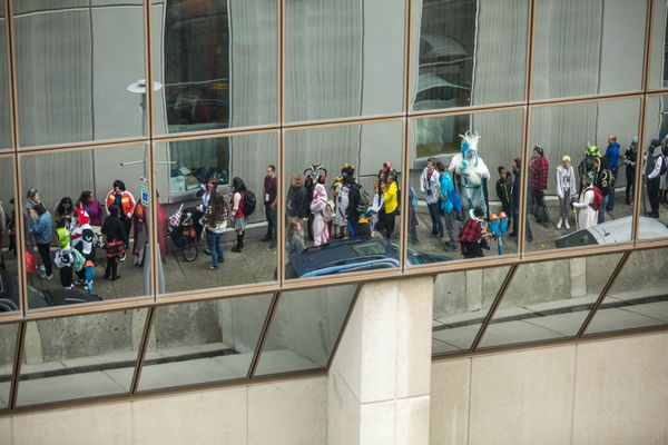 Senshi Con attendees wait in line to enter the convention Saturday, Sept. 22, 2018 at the Dena'ina Civic and Convention Center. The anime convention is in its 13th year. (Loren Holmes / ADN)