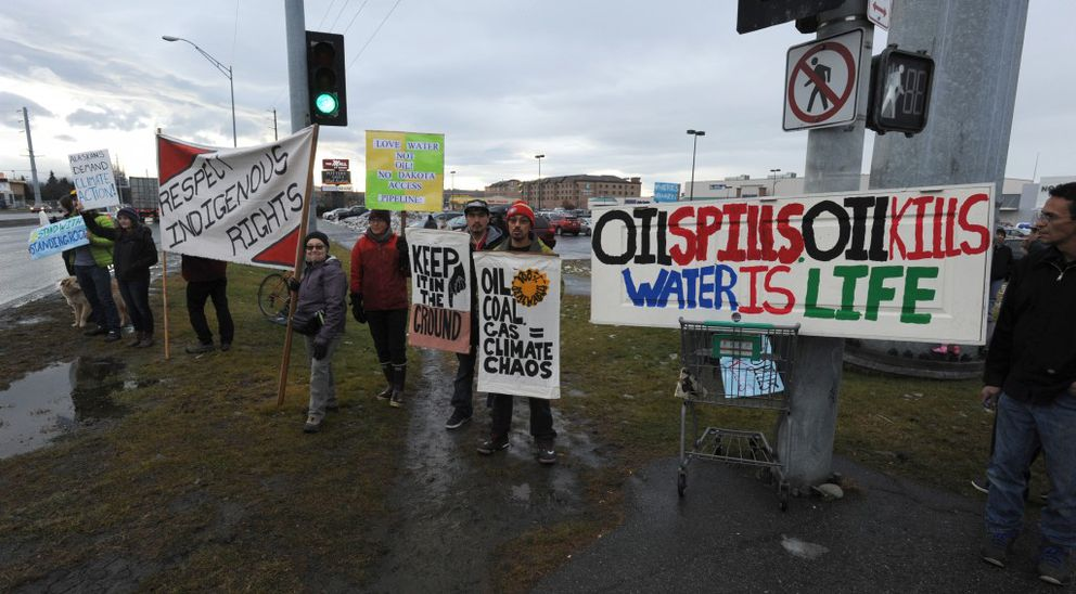 Alaskans gathered at the corner of Northern Lights Boulevard and Seward Highway to show they support for the Standing Rock Sioux Tribe with their battle against the Dakota Access Pipeline on Sunday, Oct. 30, 2016. (Bill Roth / Alaska Dispatch News)
