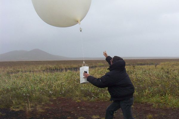 Doug O'Harra / Anchorage Daily News Meteorological technician Willy Tcheripanoff releases a helium-filled weather balloon to gather temperature, humidity, air pressure, wind speed and direction over the Bering Sea October 8, 2004. This balloon rose 110,000 feet before it burst.