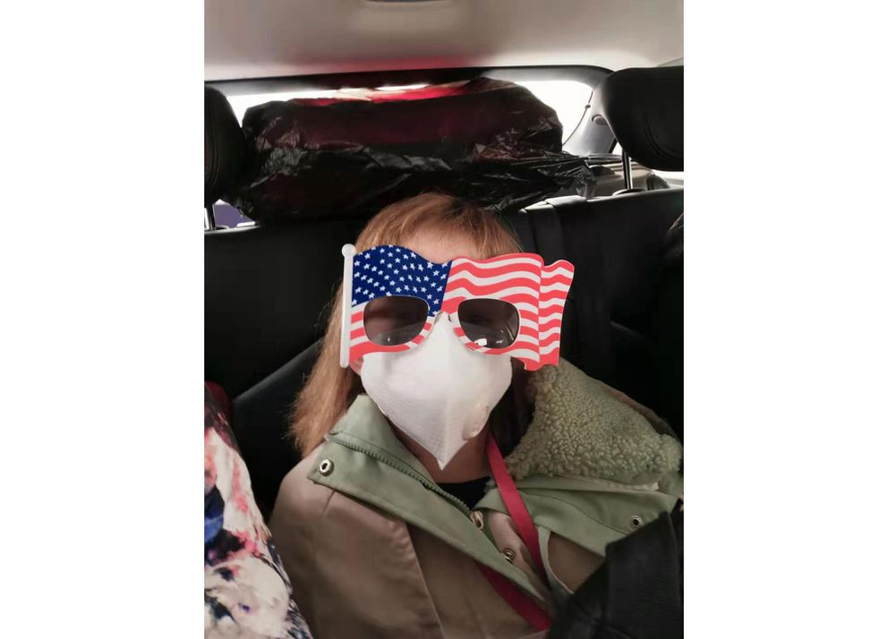Hermoine Dickey, 8, rides in a car on her way to Wuhan Tiange International Airport for a U.S. evacuation flight Tuesday, January 28, 2020. The U.S. government is chartering a flight to transport several hundred diplomats, family members, and other Americans out of Wuhan, the central Chinese city at the heart of a new virus outbreak. (Priscilla Dickey via AP)